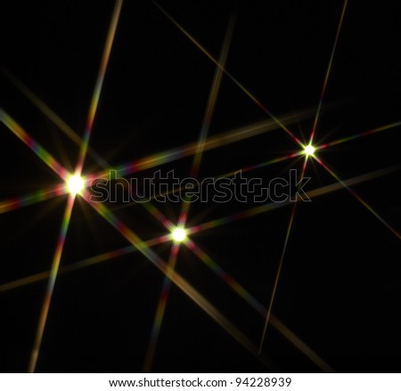colorful flashy spotlight stars made with optical star filter on camera - stock photo