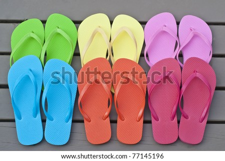 Colorful Flip Flops on the Deck