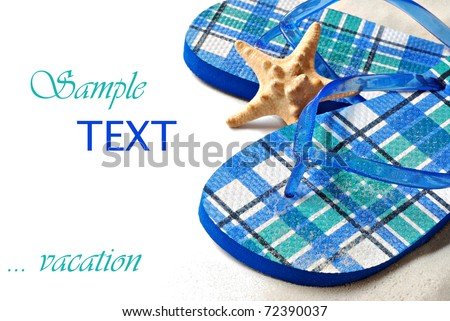 Colorful flip flops with starfish.  Sprayed with water and sprinkled with sand for effect.  Macro on white background with copy space. - stock photo