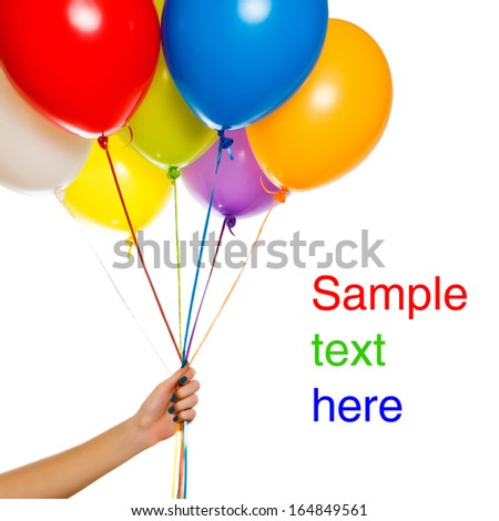 Colorful floating balloons isolated on white background. Woman hand keeping celebration or birthday party balloons - stock photo