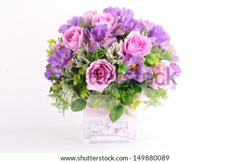 Colorful flower arrangement centerpiece in square glass vase  - stock photo