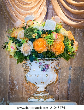 Colorful flower bouquet arrangement centerpiece in vase - stock photo