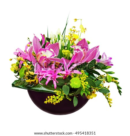 Colorful flower bouquet arrangement centerpiece in vase isolated on white background. Closeup.