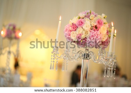 Colorful flower bouquet decoration with candles - stock photo