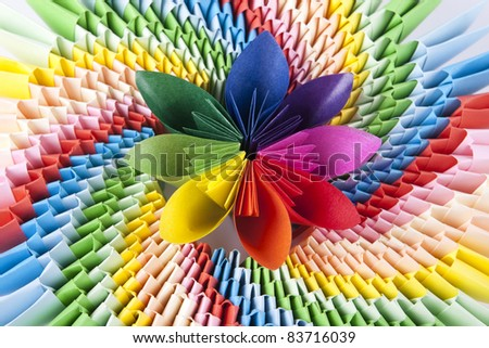colorful flower for kusudama, on the bright modular origami as a rainbow. Variegated bright background - stock photo