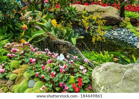 Colorful Flower Garden With Fish In The Pond