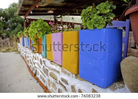 Colorful flower pots along a wall at a cafe near Karfas in Khios, Greece