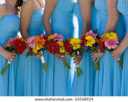 Colorful flowers and bridesmaid  gowns. - stock photo