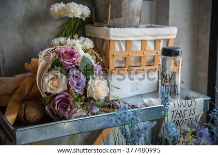 colorful flowers and empty bottle, home decoration concept