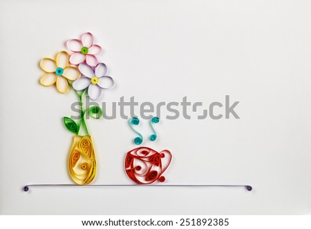 colorful flowers in a vase and a hot cup made of quilling. Location can be used for the text - stock photo