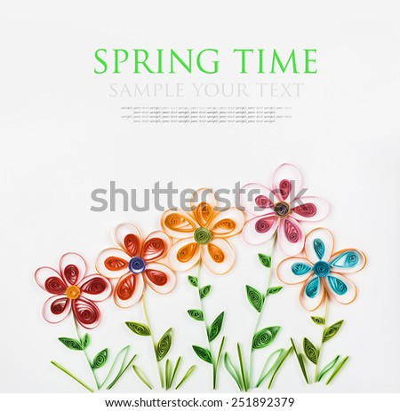 colorful flowers made quilling for spring time. The text is an example and can be easily removed - stock photo