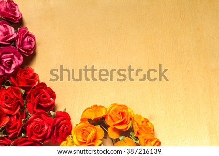 Colorful flowers paper abstract on wood background