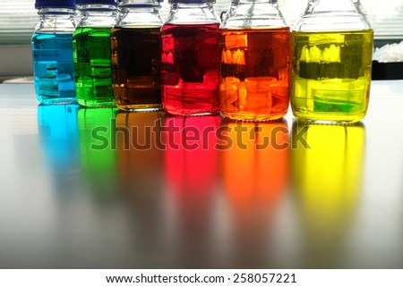 Colorful fluid in bottle for laboratory use on table laboratory  - stock photo