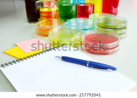 Colorful fluid in petridish for laboratory use on table in laboratory