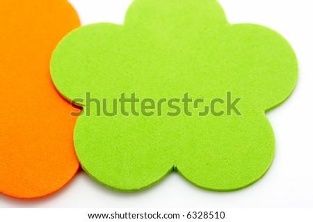 Colorful foam stickers over a white background - stock photo
