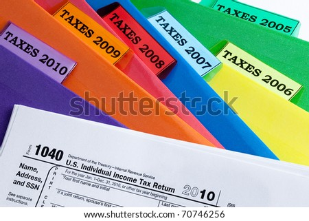 Colorful folders for income taxes of years 2010 - 2005 / TAXES & FOLDERS - stock photo
