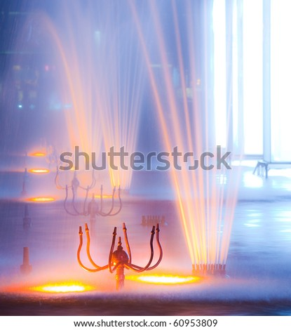 Colorful fountain at night - stock photo