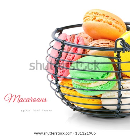 Colorful French macaroons isolated over white - stock photo