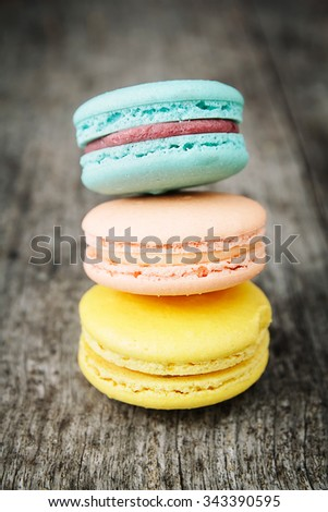 Colorful French macaroons wooden background, selective focus - stock photo