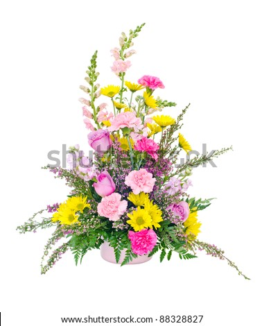 Colorful fresh flower arrangement centerpiece with daisies, carnations, roses and snapdragons isolated on white - stock photo