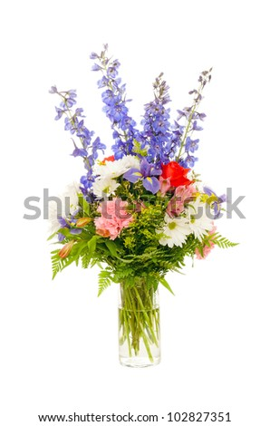 Colorful fresh flower arrangement centerpiece with purple iris, rose, carnation, daisy and delphinium isolated on white background - stock photo