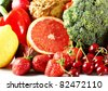 Colorful fresh group of fruits and vegetables for a balanced diet. - stock photo