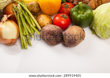 Colorful fresh mixed vegetables with white copy space