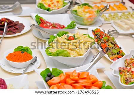 Colorful fresh salads on the table