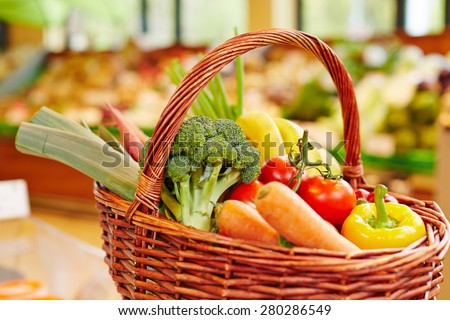 Colorful fresh vegetables in a shopping basket in a supermarket - stock photo