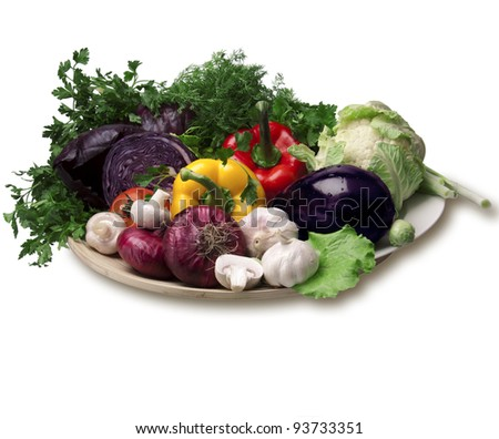 Colorful fresh vegetables on bamboo dish isolated on white