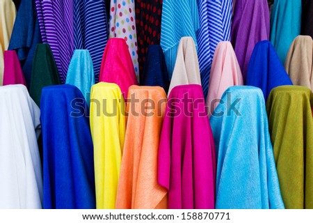 colorful from the row of fabrics in fabric store - stock photo