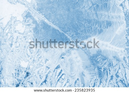 Colorful frozen window with ice and snowflakes