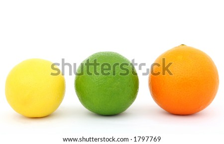 Colorful fruit, a yellow lemon, a green lime and an red coloured orange. Macro closeup, isolated on white, close-up with copyspace