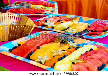 Colorful Fruit Assortment. Delightful diet of fresh sliced multicolored fruit on buffet table.