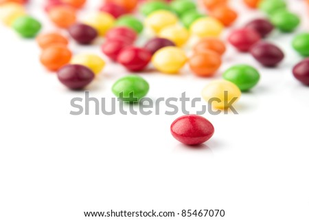 Colorful fruit candies on white background - stock photo