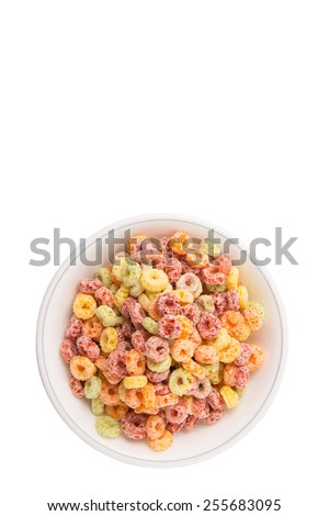 Colorful fruit flavored loops shaped cereal in a white bowl over white background - stock photo