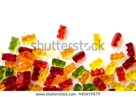 colorful fruit gum candy bears isolated with small shadow on white as a background frame, can be used horizontally or vertically - stock photo