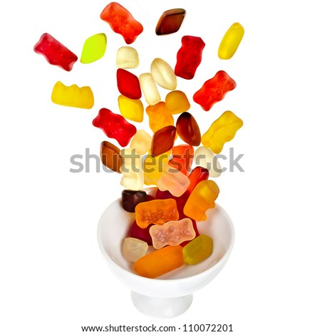 colorful fruit jelly candy in vase on a white background - stock photo