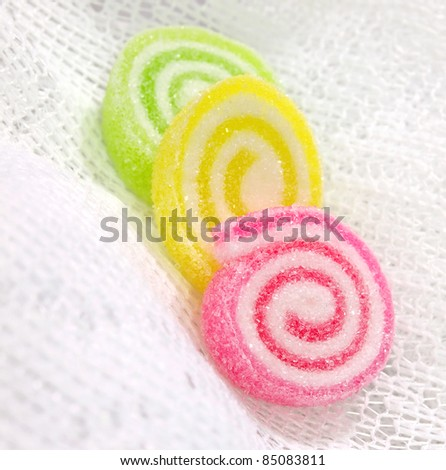 Colorful fruit jelly candy on white lace