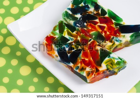 Colorful fruit jelly presented on a white plate - idea for light dessert during a hot summer