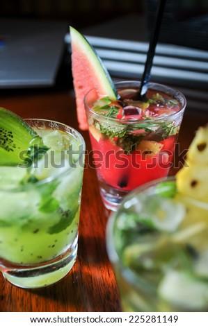 Colorful fruit Mojitos close up - stock photo