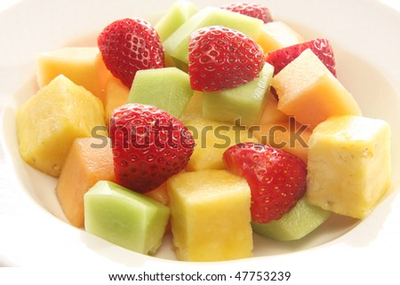 Colorful fruit salad. Also available in vertical. - stock photo