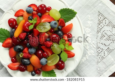 Colorful fruit salad on a white plate. Healthy food.