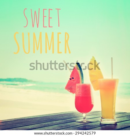 Colorful fruit smoothie drinks at the beach with SWEET SUMMER text, vintage tone - stock photo