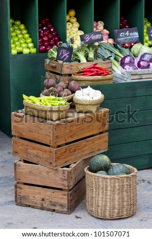 Colorful fruits and vegetables on market stand - stock photo