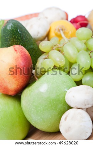 colorful fruits and vegetables together on white