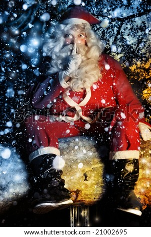 Colorful fun portrait of magical Santa Claus with snow falling - stock photo