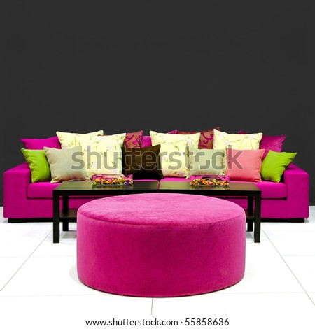 Colorful furniture with bunch of cushions on the sofa - stock photo