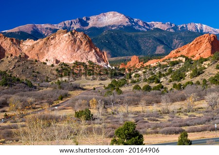 Colorful Garden of the Gods Park near Colorado Springs, Colorado with snow dusted Pikes Peak - stock photo