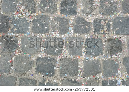 Colorful garlands, streamer and confetti left on the floor - stock photo